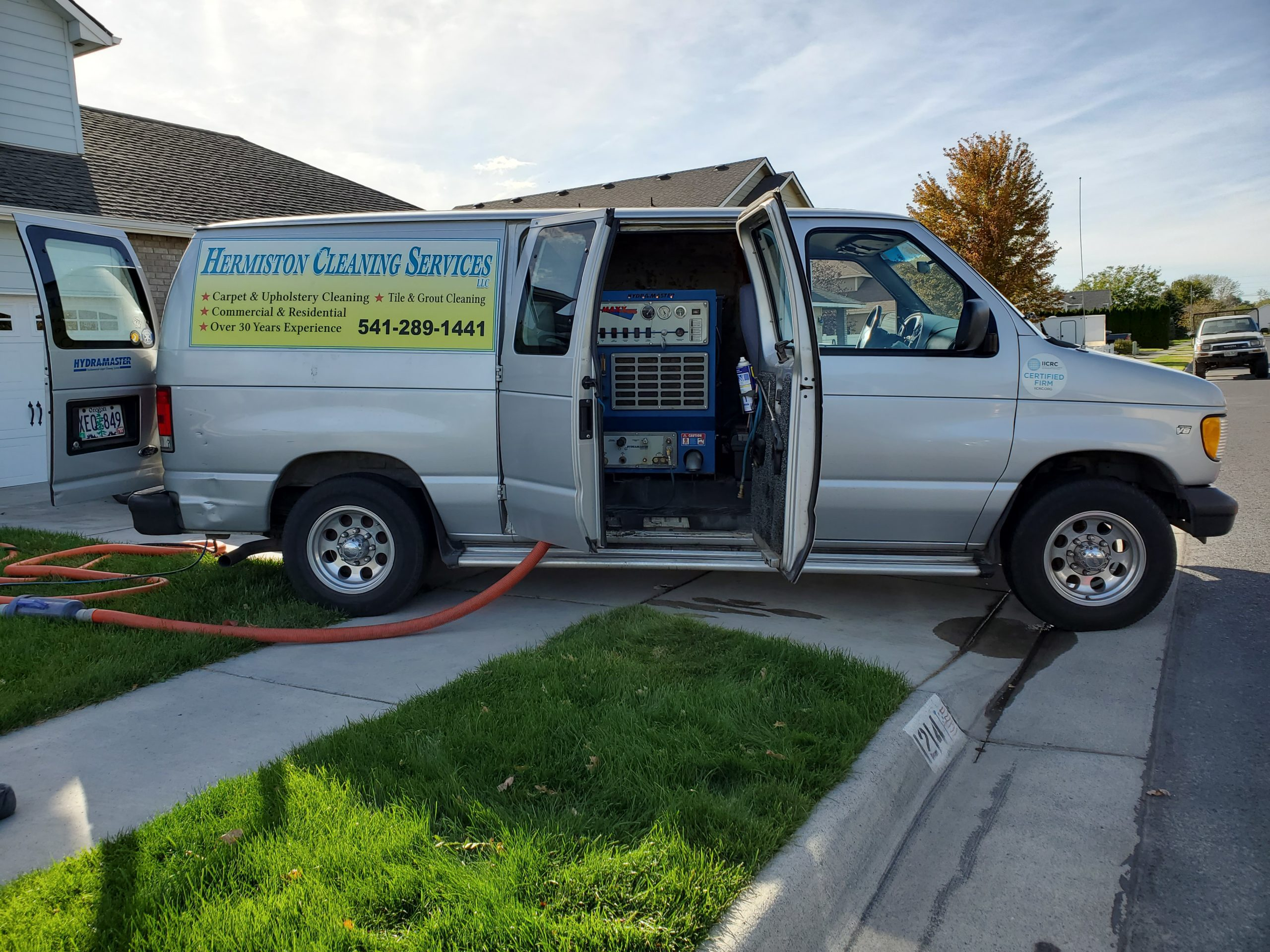 Image of van with truck mounted cleaning system.