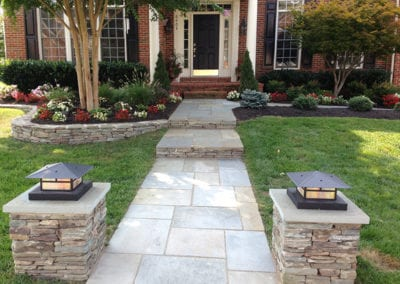 McCracken-front-yard-(lighted-stack-stone-columns_-sq-cut-walk-in-mortar_-stacked-risers)