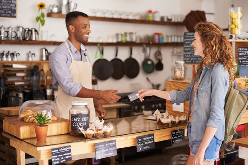 small business owner taking payment from customer