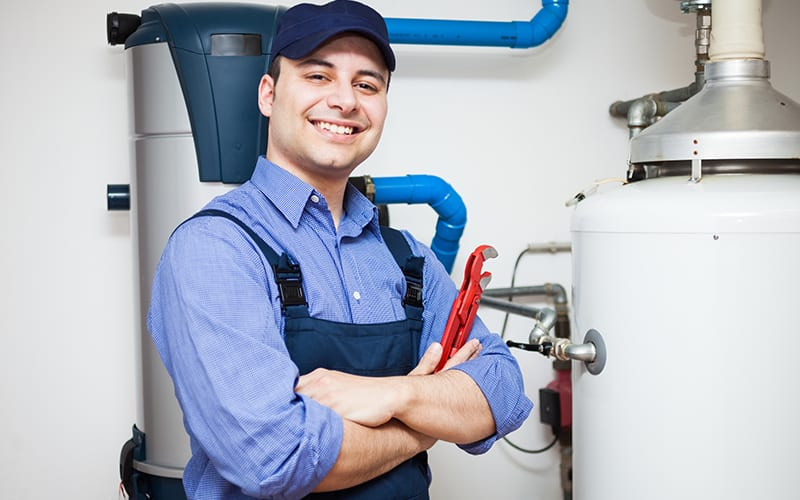 Plumber-Standing-With-Water-Heater